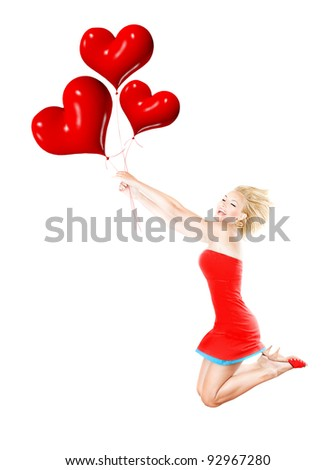 Happy girl flying, female holding red heart balloons, woman having fun and laughing, body isolated on white background, crazy in love concept - stock photo