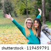 Happy girl friends in nature - stock photo