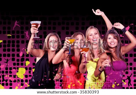 Happy girl friends on a night out with cocktails - stock photo