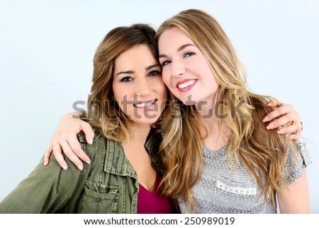 Happy girl friends smiling together - stock photo