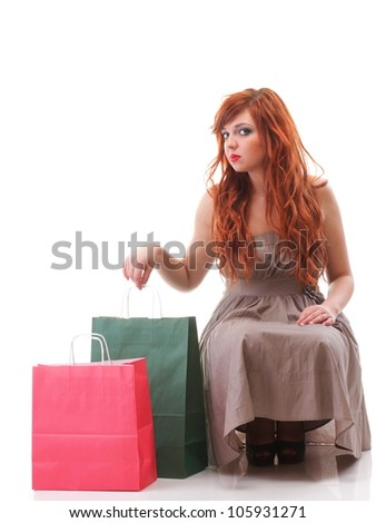happy girl ginger with shopping bags shoes over white - stock photo