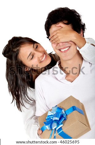 Happy girl giving a gift to her couple isolated on white - stock photo