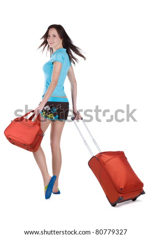 Happy girl going on vacation with suitcase over a white background - stock photo