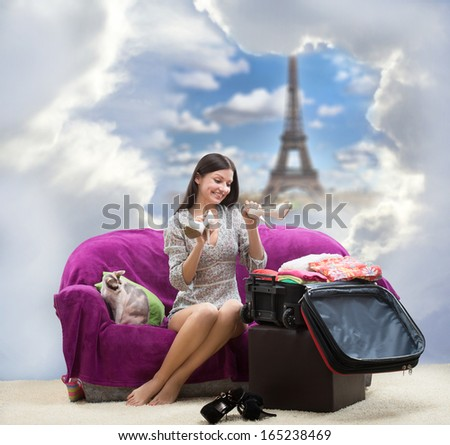 Happy girl going to Paris - stock photo