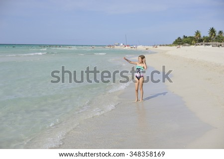 Happy girl has fun in the Caribbean sea. - stock photo