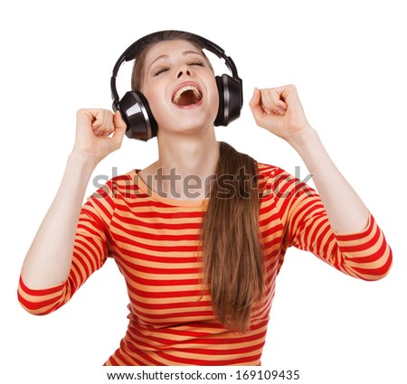 Happy girl having fun listening to music on headphones - stock photo