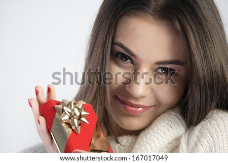 Happy girl holding a gift - stock photo