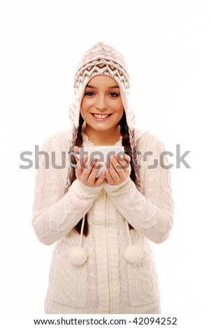 Happy girl holding coffee cup in winter clothes - stock photo