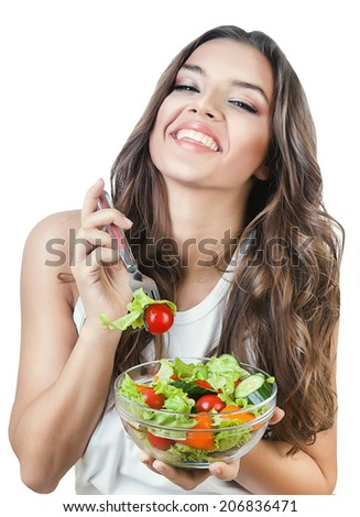 happy girl holding fork with salad on white background - stock photo