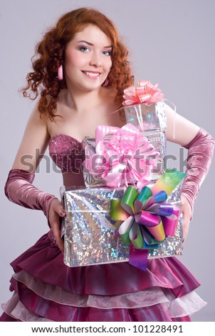 Happy girl holding gift boxes - stock photo
