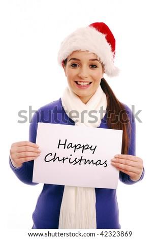 Happy girl holding 'Happy Christmas' sign - stock photo