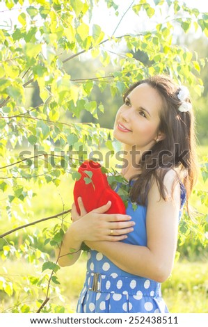 Happy girl holding heart. On nature - stock photo