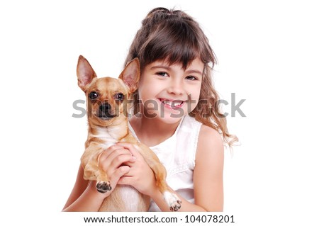 Happy girl holding her pet doggy - stock photo