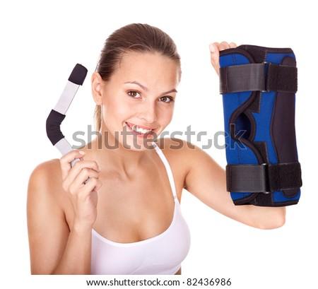 Happy girl holding hinged knee braces. Isolated. - stock photo