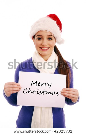Happy girl holding 'Merry Christmas' sign - stock photo