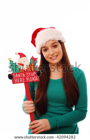 Happy girl holding santa stop here sign - stock photo
