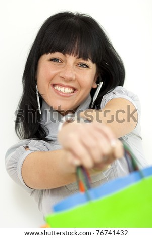 Happy girl holding shopping bags - stock photo