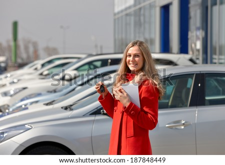 happy girl holding the keys to a new car - stock photo