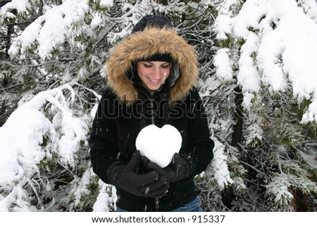 Happy girl holds Heart: Room for copy - stock photo