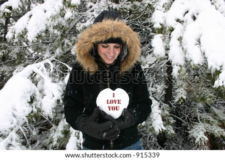 Happy girl holds heart that says I love you. - stock photo