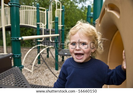 Happy girl in a blue sweatshirt at a park - stock photo