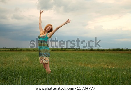 Happy girl in a field
