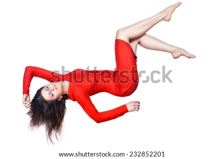 Happy girl in a red dress falls, she arranged the arms and legs, on white background. - stock photo