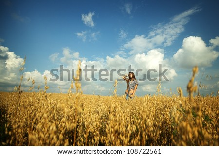 Happy girl in a yellow field