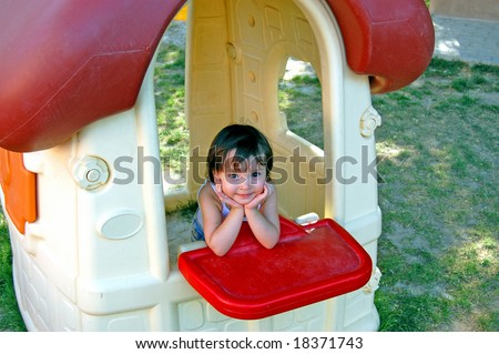Happy Girl in Children's Village with bluffing smile - stock photo