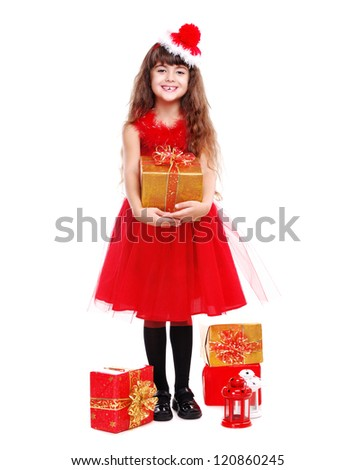 Happy girl in Christmas dress holding the present box on white background - stock photo