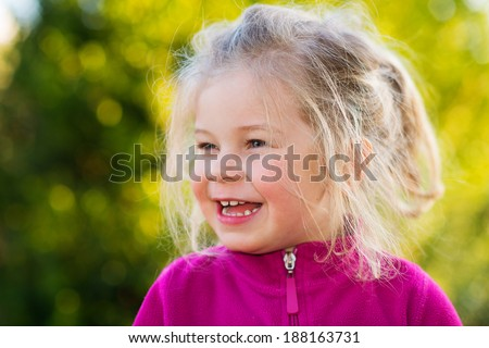 happy girl in front of nature- background - stock photo