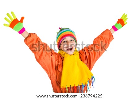 Happy girl in orange winter sports overalls, isolated on white