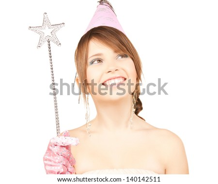 happy girl in party cap with magic stick - stock photo
