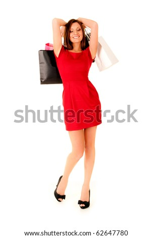 happy girl in red dress wearing black shoes with paper bags smiling and enjoing life