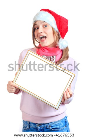 Happy girl in red santa hat holding blank sign - stock photo