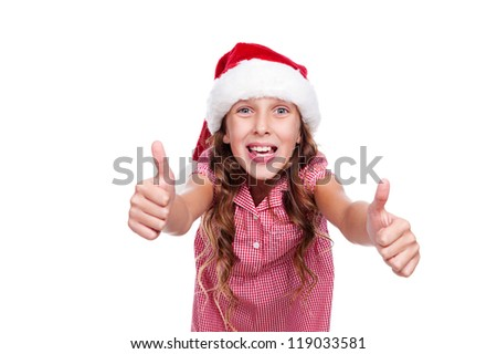 happy girl in santa claus hat showing thumbs up. isolated on white background - stock photo