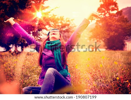 happy girl in sunset in a meadow - stock photo