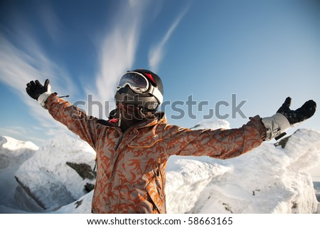 Happy girl in the mountains of the arms are raised up - stock photo