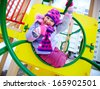 Happy girl in winterwear having fun on playground - stock photo