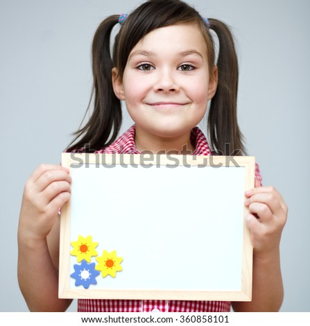 Happy girl is holding blank banner - stock photo