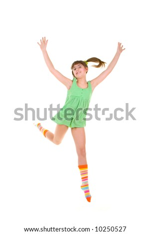 Happy girl is jumping over white background