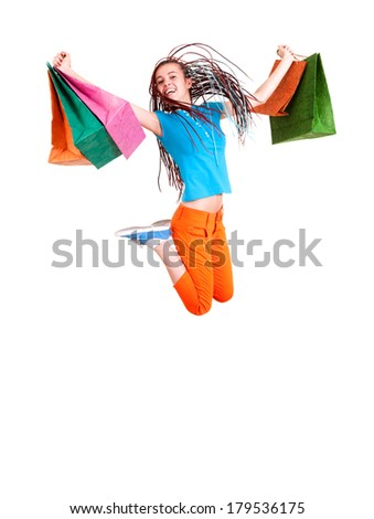 Happy girl jumping with shopping bags, white background - stock photo
