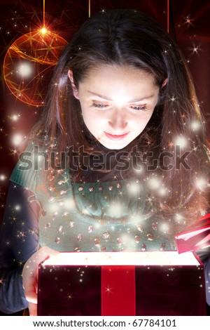 happy girl looking into gift box - stock photo