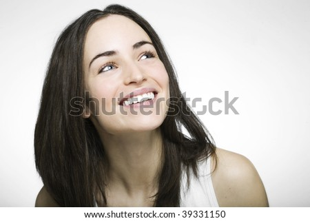 happy girl looking up laughing and smiling - stock photo