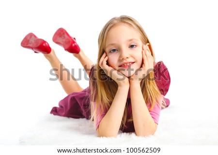 Happy girl lying on floor, isolated on white - stock photo