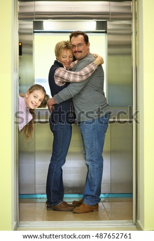 Happy girl near a pair of embracing men and women