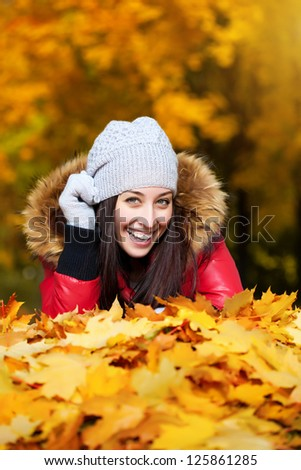 happy girl on a autumn trees background