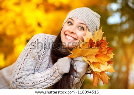 happy girl on a background of autumn trees