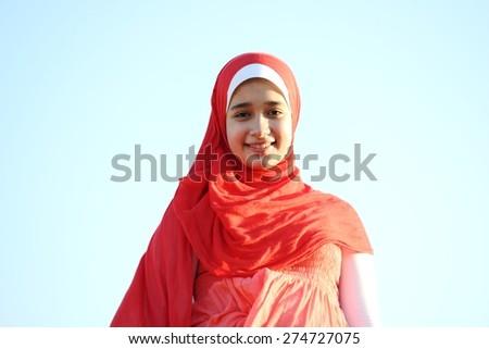Happy girl on meadow - stock photo