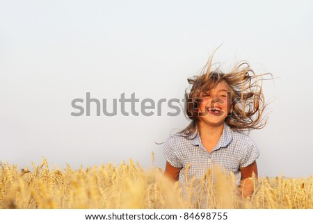 happy girl on natural background - stock photo